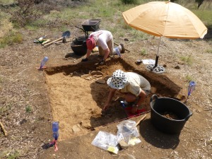 Olynthos Project 2014 members excavate a small 2 x 2 meter trial trench.