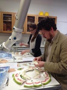 IPCAA students Dan Diffendale and Alison Rittershaus reconstruct broken ceramics.