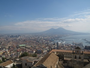 A view of Naples from a hilltop castle. That very straight street at the lower left is one of the Roman decumani, still in use as a main road today.
