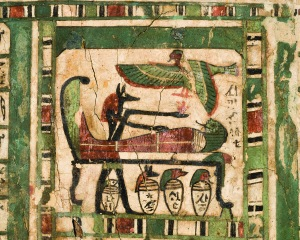Djehutymose lies on a funerary bed, where he is being embalmed by the jackal-headed god Anubis. His soul (ba) in the form of a human headed bird, hovers overhead. Beneath the bed are four canopic jars containing Djehutymose's internal organs, removed during the mummification process.