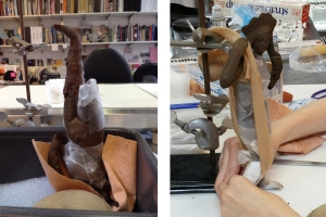 At left, the glue is setting for the finished left leg. At right, the right leg is being shaped in place on the figurine.