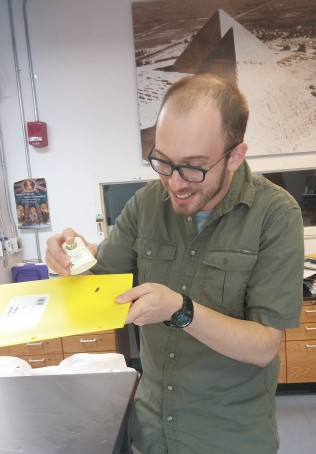 IPCAA student Drew Cabaniss presents a suspicious-looking beetle for our review