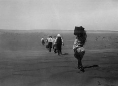 "Image KS175_03: April 27, 1920; George R. Swain; Dimay trip. ""Hiking over the sands to Dimay. Porter first, then Professor [Francis W.] Kelsey."""