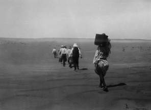 """Image KS175_03: April 27, 1920; George R. Swain; Dimay trip. """"Hiking over the sands to Dimay. Porter first, then Professor [Francis W.] Kelsey."""""""