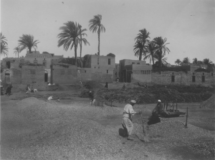 "Image KS175_11: April 28, 1920; George R. Swain; ""Winnowing grain on a threshing floor, village with scattered palms in the background."""