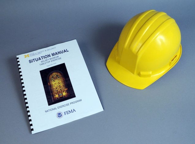 spiral bound pamphlet and yellow hard hat