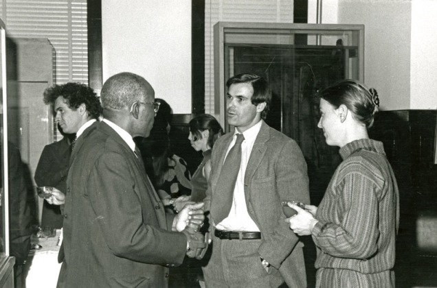 photo of three people talking.