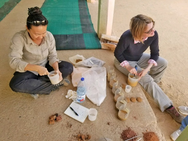 two women mixing mortar
