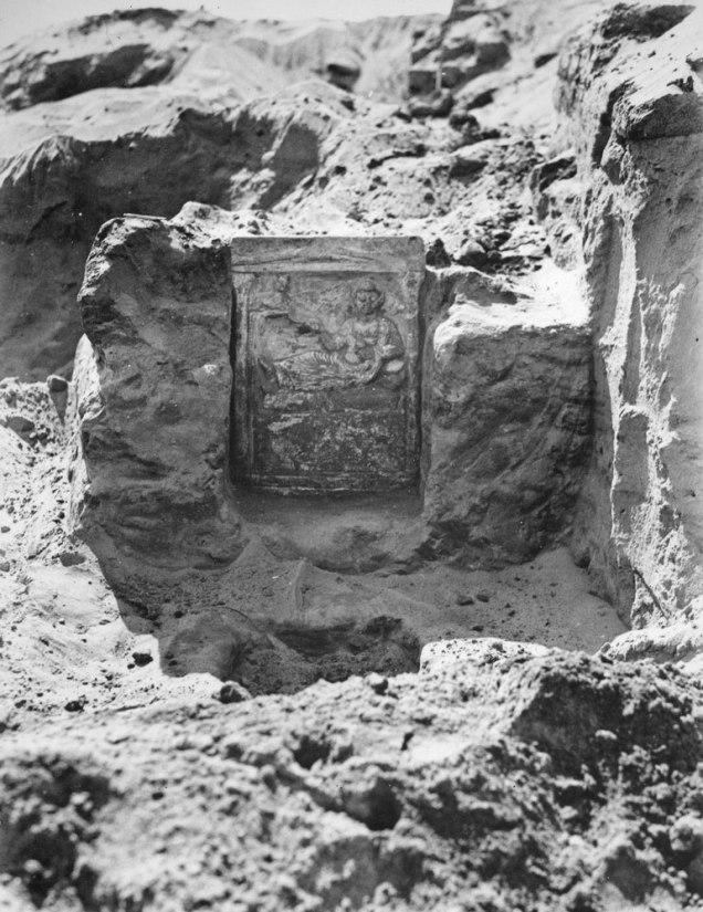 stone stela in situ.