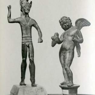 Two statuettes: warrior and Cupid.