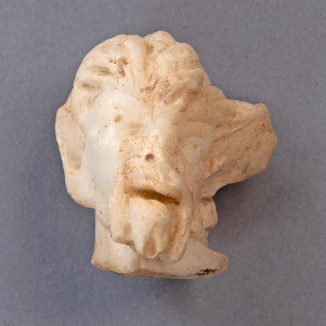 photo of a marble head of a faun