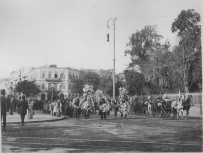 Cairo, Egypt. A funeral procession coming along a main street -- note the flowers. KS147.08.
