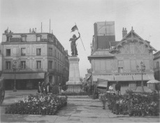 Compiegne, France. Statue of Joan of Arc, flower market in front. KS228.11.